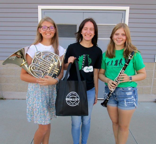 """Geneseo band and choir students from left, Madison Holevoet, GHS senior, band and choir and drum major; Rose Henderson, GHS senior, choir president; Taylor Davis, GHS junior, band and drum major; show some of the prizes to be awarded in raffle drawings at the 27th annual Harvest Time Music Festival, Saturday, Sept. 25, and Sunday, Sept. 26. Prizes include one year of free groceries form Geneseo Fareway, 50"""" 4K Dolby Vision Vizio TV, Sony 4K UHD Blu-Ray DVD Player, Lenovo Idea pad and Accessories, Canon Wireless Printer, Nintendo Switch with headset and case and a $50 Nintendo Gift Card."""
