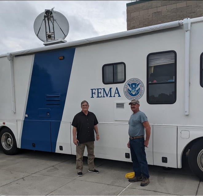 Gonzales Mayor Barney Arceneaux stands in front of a FEMA vehicle.