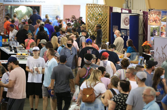 People walk through and look at the many booths inside the Pride of Kansas building Saturday, Sept. 11, 2021, at the Kansas State Fair.