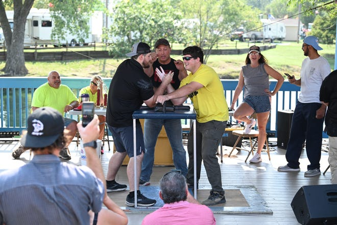 Brothers Devin (left) and Jarod (right) Gagnebin get ready to face off near Lake Talbott at the Arm Wrestling USA Kansas State Fair tournament.