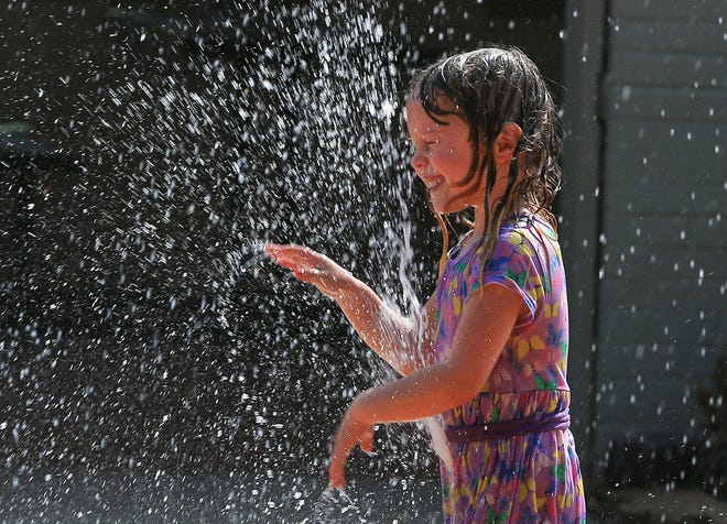 Adley Roat, 4, from Hoisington, enjoyed her time playing with the water shooting up at the Lair Steckline Fountain Saturday at the Kansas State Fair.