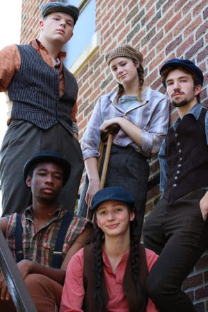 """Five """"Newsies"""" from the 35-member cast of the upcoming Sterling College Theatre musical are pictured here: Luke Harding of Sterling plays the leading character Jack Kelly (standing, left). Next to him is Aubrey Anderson (Sterling) who plays Crutchie and  Dylan Werth (Hays) who plays Davey. Sitting left is Torey Wilson from Rural Hill, NC who plays newsie Albert and Rachel Thomson from Hutchinson who is playing Buttons and also acting as choreographer and dance captain for the show."""