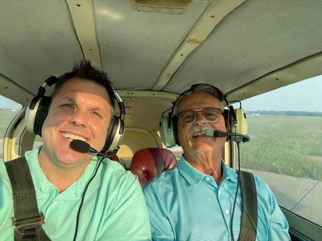 Dr. Gary Pease, right, prepares to take off from the Hutchinson Regional Airport on Sept. 12 with flight instructor Tom Bartholomew. Pease, who stopped flying two years ago, wanted to return to the controls for his 80th birthday.