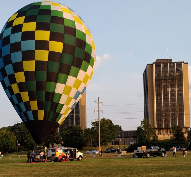 A balloon is fired up for takeoff on Friday at the Macomb Balloon Rally launching at WIU'sVince Grady Field.