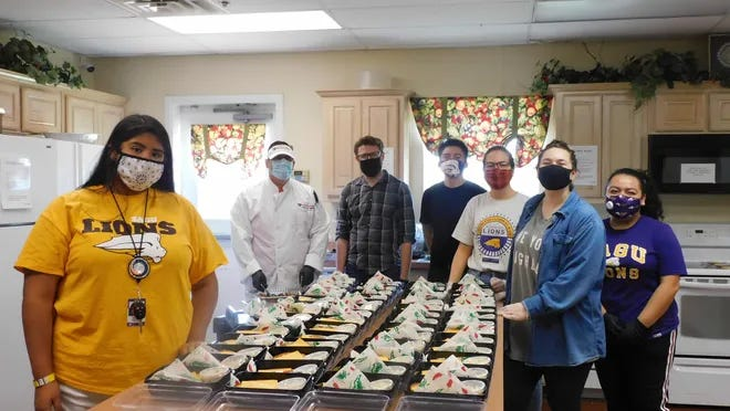 """SAGU student volunteers help prepare lunch for the Ellis County Homeless Coalition's """"Lunch and Learn"""" event last September. The coalition recently received 501c3 non-profit designation and is stepping up efforts to provide service to those without homes or in danger of losing housing."""