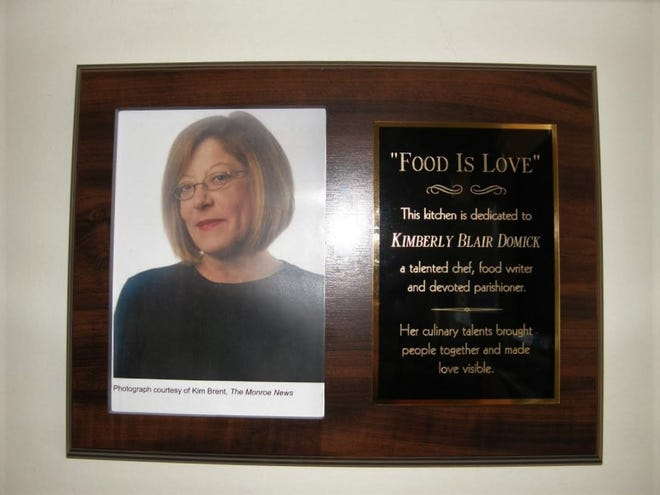 Hanging on a wall in Trinity Episcopal Church's kitchen is this plaque dedicated to honor Kim Domick, who passed away earlier this year. Domick was a food writer for The Monroe News. Her first column was published on December 5, 2010.
