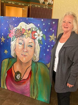 Dr. Paula Whitman was surprised when her portrait was unveiled during Saturday's golf outing fundraiser for Paula's House.