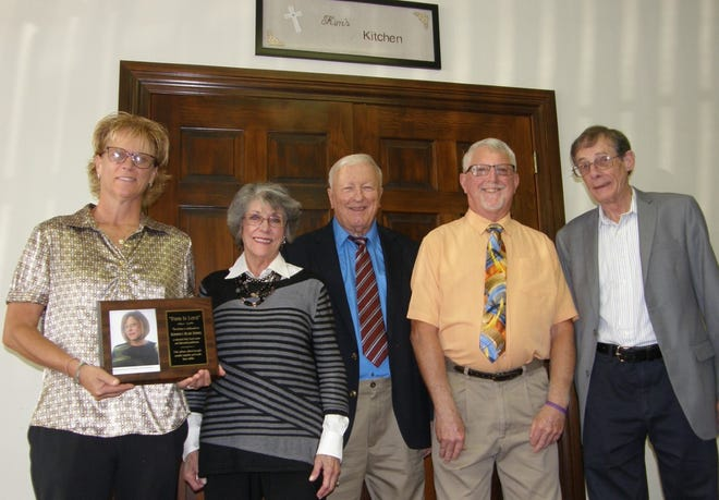 As part of Trinity Episcopal Church's 190th anniversary, the vestry dedicated the kitchen to honor Kim Domick, a talented chef, food writer and devoted parishioner. Pictured (left to right) are vestry member Kris Hudson, Kim's mother Julia Domick, senior warden David Potter, junior warden Tim Schilling and treasurer Allen Pixley. Not pictured: Jay Armstrong, Christ Langerman and Ardith McNew.