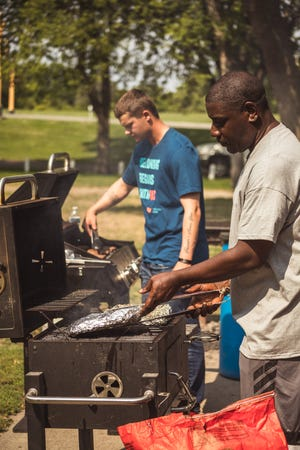 Keith Moore of Moore Good Eats serving ribs at the Welcoming America event in Montevideo last weekend.