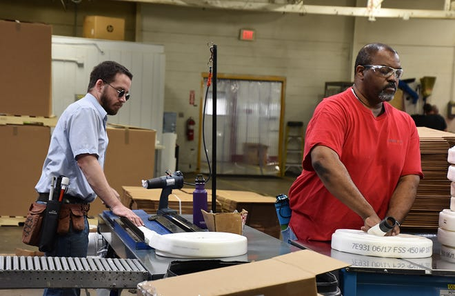 Employees manufacture fire hoses at the NewView facility in Oklahoma City. [Photo provided]