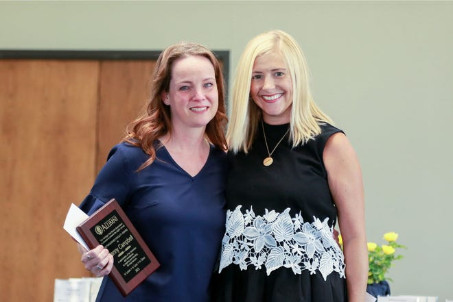 Heritage Hall alumna Ashley Stark Ford presents the 2021 Heritage Hall Alumni Association Distinguished Faculty Award to school nurse Jenny Campbell during the school's annual Faculty Recognition Luncheon.