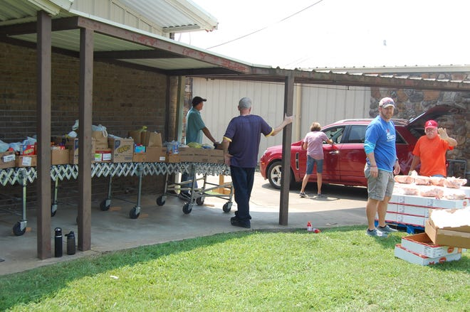 Volunteers help distribute produce and food items to residents of Crawford and Franklin counties this summer during an event hosted by the Mulberry Food Pantry.