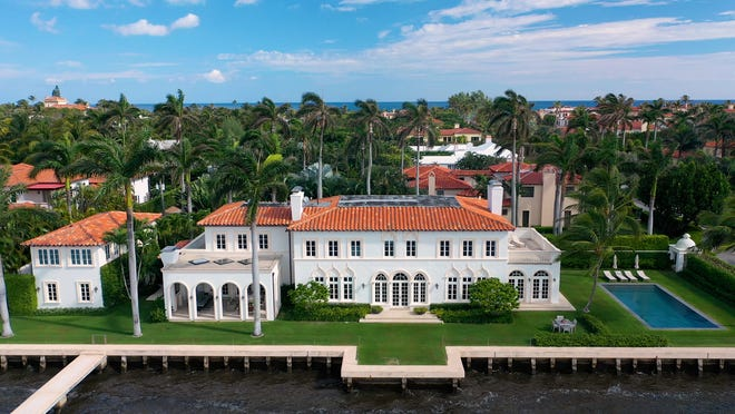 """A landmarked lakeside house at 181 Clarendon Ave. is featured in the """"Landmarks Discovered"""" video series produced by the Preservation Foundation of Palm Beach. The video on the house spotlights how a major renovation-and-restoration project raised the structural foundation to protect the home from flooding."""