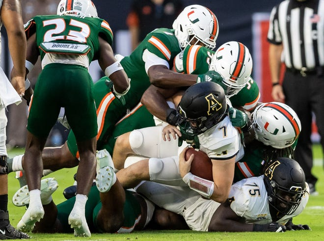Miami Hurricanes defense smothers Appalachian State quarterback Chase Brice during Saturday's game at Hard Rock Stadium. Richard Graulich-USA TODAY Sports