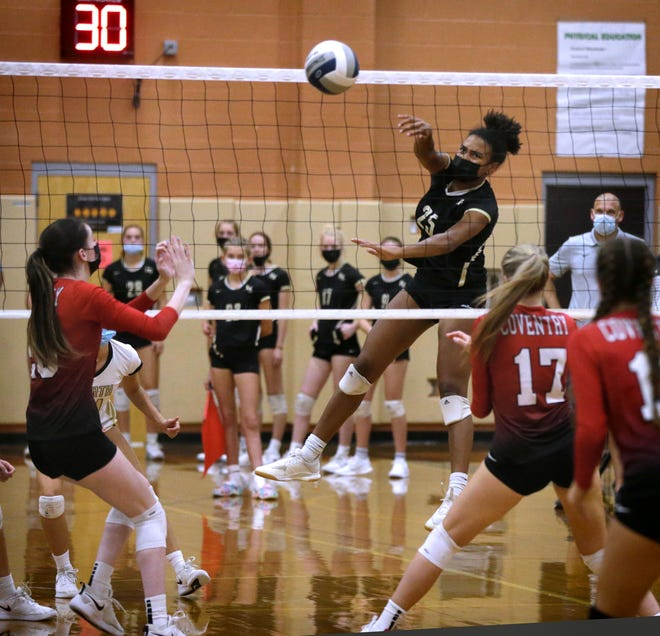 North Kingstown RI, Sept 13, 2021 - North Kingstown's Skipper Cassidy Cole spikes the ball over the Oaker net for North Kingstown.  North Kingstown's Skippers take on the visiting Coventry Oakers in girls volleyball action Monday evening.   [The Providence Journal / Kris Craig]
