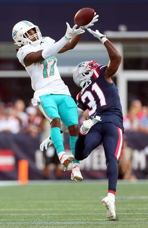 Miami rookie Jaylen Waddle (17) is leading NFL wide receivers in receptions and yards through five games.