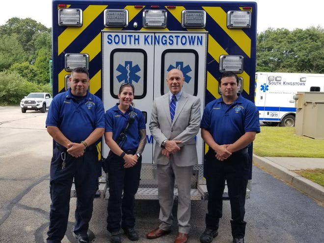 State police Col. James Manni, with South Kingstown EMS Capt. Frank Capaldi and Paramedic Sarah Peet to his left. Paramedic Keith DeCesare is to his right.