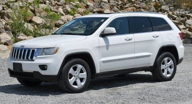 Providence police are seeking a 2012 white Jeep Cherokee Laredo, similar to some for sale on the Kelly Blue Book website, like this one selected as a generic example of what a carjacking victim described to police.