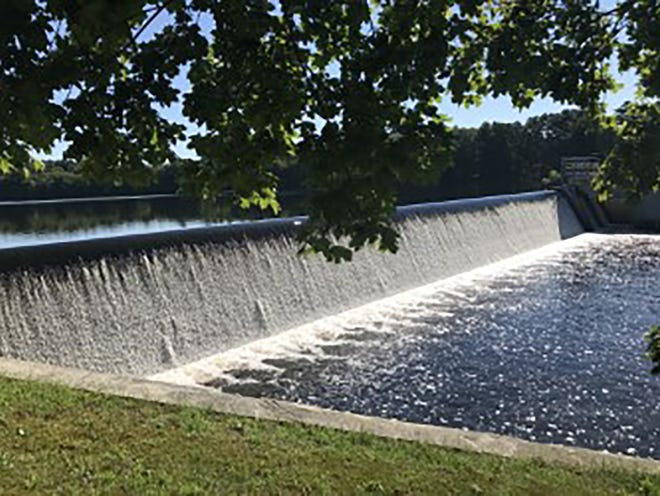 The water from the James Turner Reservoir, in East Providence, flows over an 18-foot dam and creates a long waterfall.