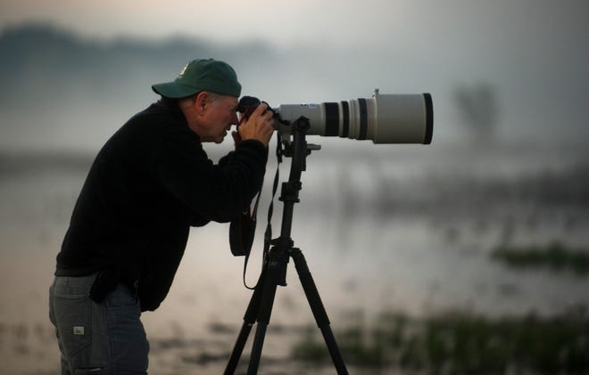 Barry Strouther of Folsom photographs a supermoon gracing the sky over the Cosumnes River Preserve near Thornton on Nov. 14, 2016.