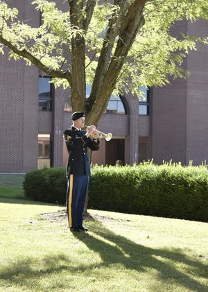 Sgt. Mason Rorapaugh, 399th Army Band, performs Taps during the Patriot Day remembrance ceremony Sept. 9 at the Maneuver Support Center of Excellence Plaza. Photo by Brian Hill, Fort Leonard Wood Public Affairs Office