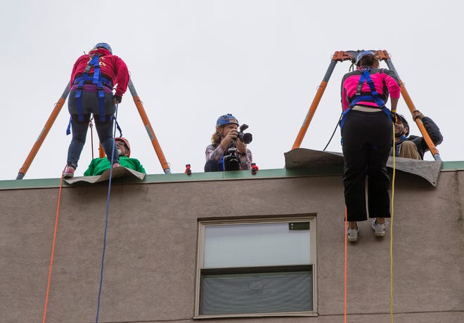 People get ready to rappel off the Robertson's Apartment Building as a part of the Over The Edge challenge for Youth Service Bureau in 2019 in downtown South Bend. The event returns Oct. 1.