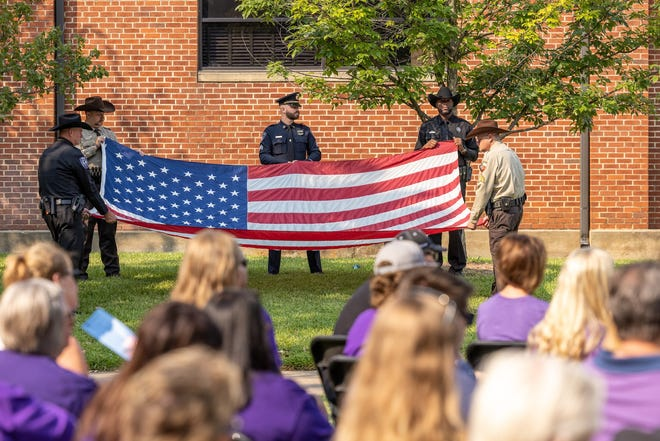 Officers with the Stephenville and Tarleton police departments and Erath County Sheriff's Office fold an American flag during Saturday's service to commemorate the 20th anniversary of the Sept. 11, 2001, terror attacks on the U.S.