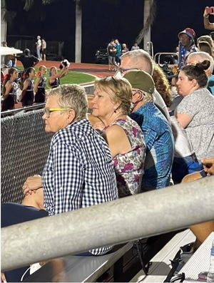 Sarasota County School Board Chairwoman Shirley Brown (second from left) was photographed not wearing a mask at Friday night's football game, despite advocating for a mask mandatory policy that requires masking at all times when not socially distanced.