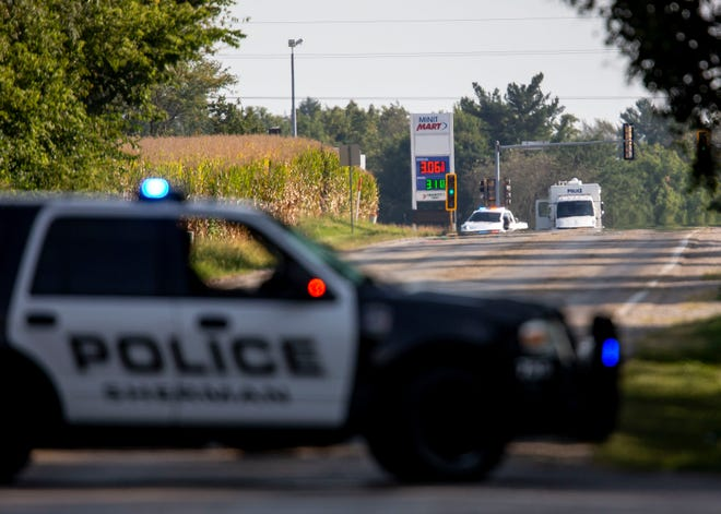 Sherman Police block Illinois 29 as the Illinois Secretary of State Hazardous Device Unit responds to the Alliance Community Bank at the intersection of Andrew Road, just north of Springfield, Ill., after a woman took an unknown amount of cash telling bank employees the box she was carrying contained a bomb around 2:30 p.m on Monday, September 13, 2021. [Justin L. Fowler/The State Journal-Register]