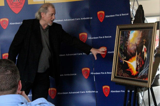Artist Greg Beilke unveiled a painting created for the  Aberdeen Fire Departments Saturday.