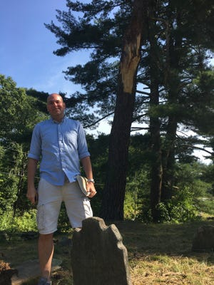 Jason Bowns, president of the Grave Guardians Association, at the Old Plainfield Cemetery where an endangered flower once again bloomed this year.