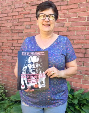 Mrs. Patti Shaulis, boosters treasurer, is shown with the latest edition of the Red Raider End Zone. The fourth edition of the Red Raider End Zone is now available for purchase. This commemorative book features photos and schedules of the 2021-2022 Red Raider athletic teams and is published by the Meyersdale Red Raider Area Athletic Boosters. Copies will be available for purchase at all fall sporting events.