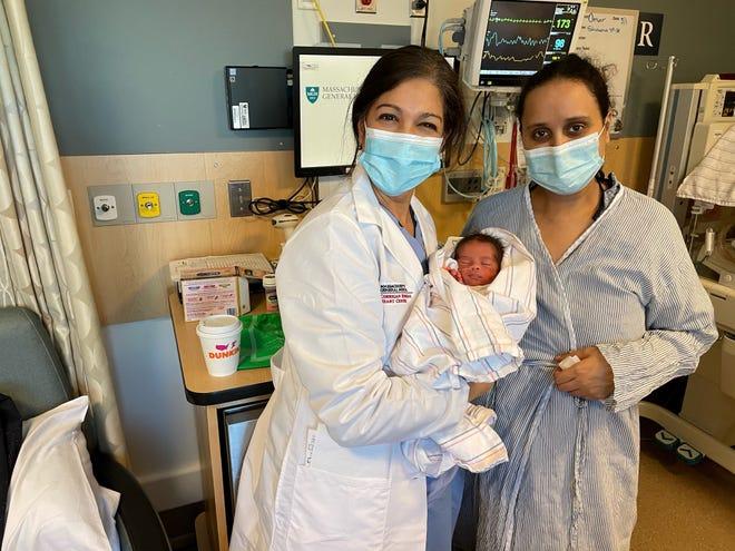 Saida Rizki, right, a congenital heart defect patient, and Dr. Doreen Defaria-Yeh of Massachusetts General Hospital in Boston hold Rizki's newborn baby at the hospital