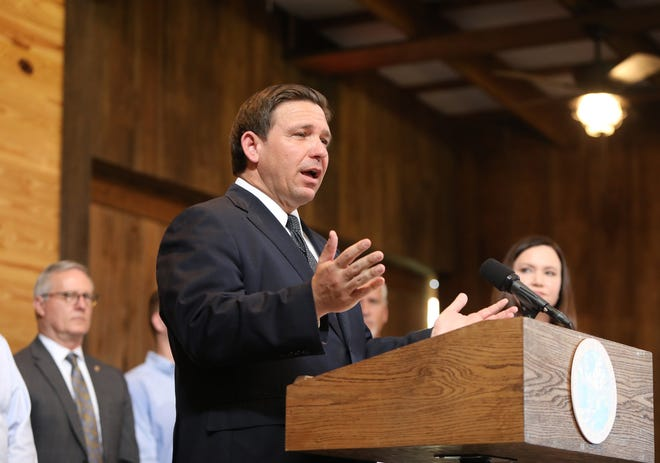 Florida Gov. Ron DeSantis delivers comments during a raly against vaccine mandates held at Clark Plantation in Newberry on Sept. 13.