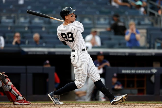 Yankees' Aaron Judge hits a three-run home run against the Minnesota Twins during the eighth inning on Monday in New York. The Yankees overcame a five-run deficit to beat the Twins 6-5.