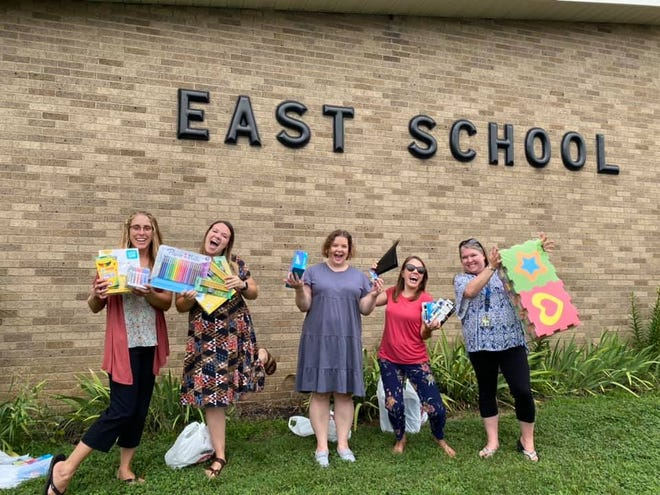 East School teachers Sarah Johnson, Aly Zufelt, Danielle Simmerman, Lydia Gadd and Rebecca Depuy help show some of the donations made by the Home Plate Project to help teachers get ready for the opening of the 2021-22 school year.