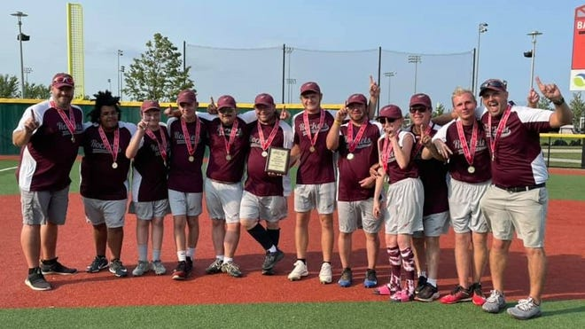 Rockets Maroon pose with their gold medals and state champion plaque.