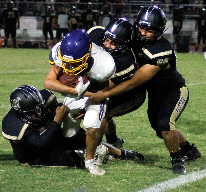 Taft High's Richard Rodrigues struggles for yards against Foothilll.