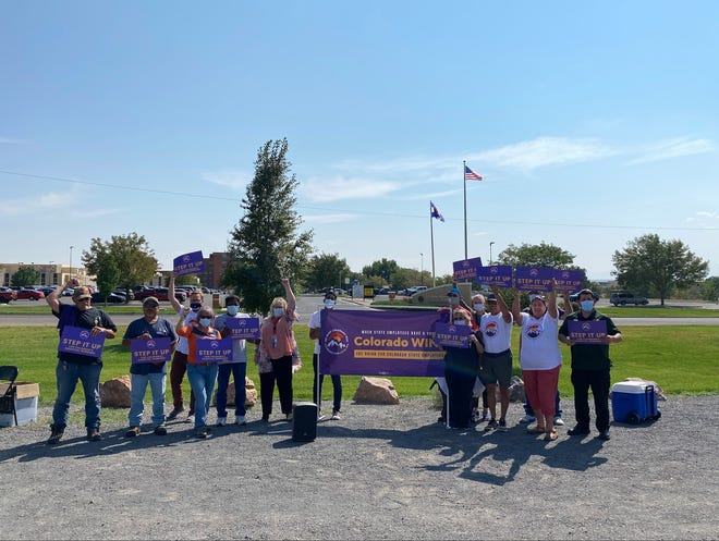 Workers of the Colorado Mental Health Institute in Pueblo held a brief demonstration Friday, Sept. 10 to support higher wages.