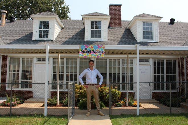 Patrick Boze, executive director, stands outside Sweet House, located at 145 Sweet Ave. in Fort Smith.