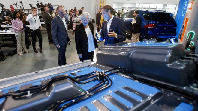 Gov. Kay Ivey, center, views a general model of a battery as Markus Schaefer, head of production planning, explains how it will be used in future electric cars produced at Mercedes-Benz U.S. International during the 20-year celebration at MBUSI in the 167 body shop at the plant in Vance on Thursday, Sept. 21, 2017. .  [Staff Photo/Erin Nelson]