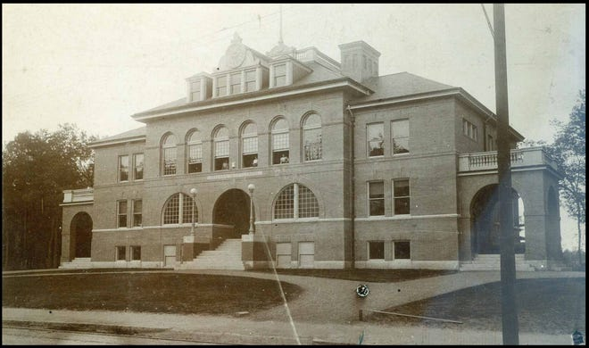 Pictured is the Needham High School/Emery Grover Building, probably taken c. 1900, shortly after it was completed. The clock face above the entrance is now at the Needham History Center.
