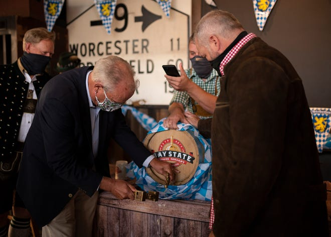 Mayor Joseph Petty taps the first keg at Bay State Brewing's Oktoberfest Sept. 16, 2020. He'll return again to do the honors for this year's expanded festival.