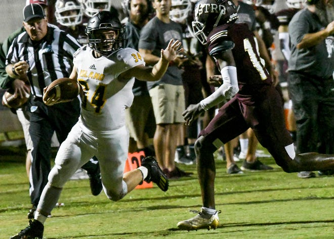 Dominic Shields of Merritt Island is dragged down by Khylil Murray during their game Friday, Sept. 10, 2021. Craig Bailey/FLORIDA TODAY via USA TODAY NETWORK