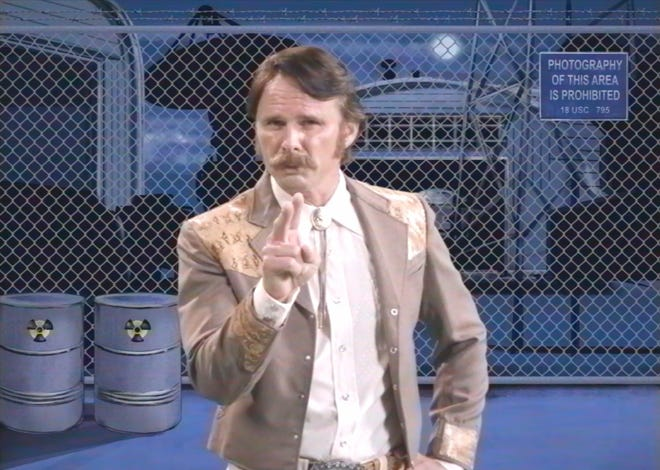 """John Bronco (Walt Goggins) in a scene from """"John Bronco Rides Again,"""" a sequel to the short comedy about a mythical Ford pitchman."""