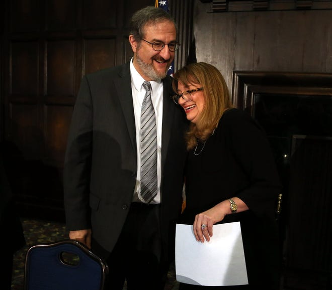 New University of Michigan president Mark Schlissel talks and has a laugh with Andrea Fischer Newman, chair of the Board of Regents, at the Michigan Union. Schlissel was appointed on Friday, Jan. 24, 2014. Eric Seals/Detroit Free Press