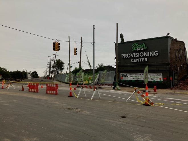 A suspected water main break caused an 8-foot mound to inflate in the middle of Dearborn Street on Sept. 11, 2021. It has affected nearby gas and electric lines in southwest Detroit. Officials with the city and DTE Energy are investigating.