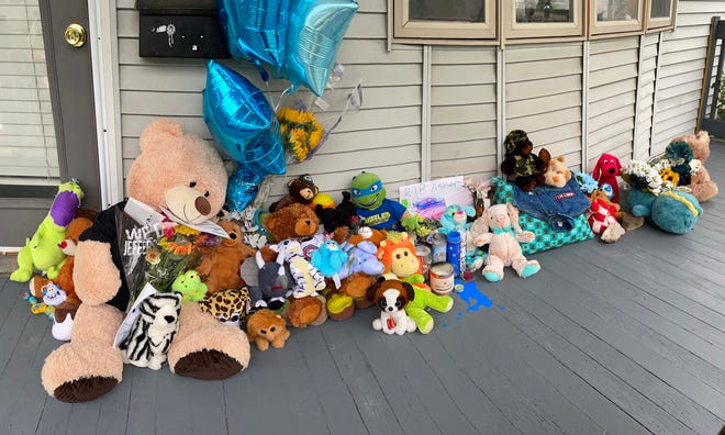 A memorial of stuffed animals and other items are placed on the porch of the West Allis home of 6-year-old Hank F. Brown-Rockow who was stabbed in the abdomen and died from blunt-force trauma, prosecutors said. Prosecutors say a West Allis woman restrained her son in handcuffs for hours at a time, denied him food and refused him medical treatment for severe injuries from abuse, causing his death.