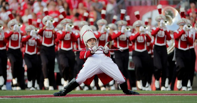 Wisconsin drum major Joshua Richlen and the marching band perform before Wisconsin's game Saturday, September 11, 2021, at Camp Randall Stadium in Madison. Richlen is from Greendale. Wisconsin beat Eastern Michigan 34-7.