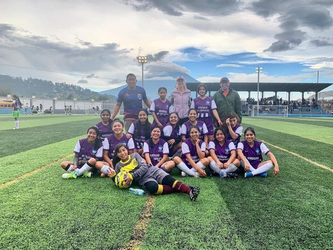 Ryan McRoberts, back row center, volunteers to coach an under-20 girls soccer team in Sacatepequez, Guatemala, as part of her Peace Corps mission.